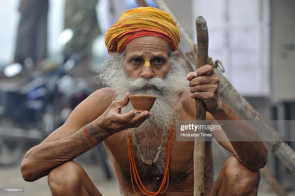 A Hindu sadhu having morning tea near Saryu Ghat on August 28, 2013 in Ayodhya, India. Three days after Vishwa Hindu Parishad (VHP) field Parikarma attempt, Ayodhya saw a heavy presence of security personnel amid Janmashtmi celebrations.