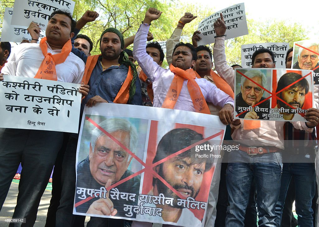 Hindu sena activist conducts protest & burn posters against J&K chief minister Mufti Mohammad Sayeed & the JKLF chairman <a gi-track='captionPersonalityLinkClicked' href=/galleries/search?phrase=Yasin+Malik&family=editorial&specificpeople=691200 ng-click='$event.stopPropagation()'>Yasin Malik</a> after their interfere in rehabilitation to Kashmiri Pandit at a separate colony at Jantar Mantar in New Delhi.