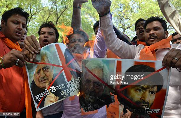 Hindu sena activist conducts protest burn posters against JK chief minister Mufti Mohammad Sayeed the JKLF chairman Yasin Malik after their interfere...