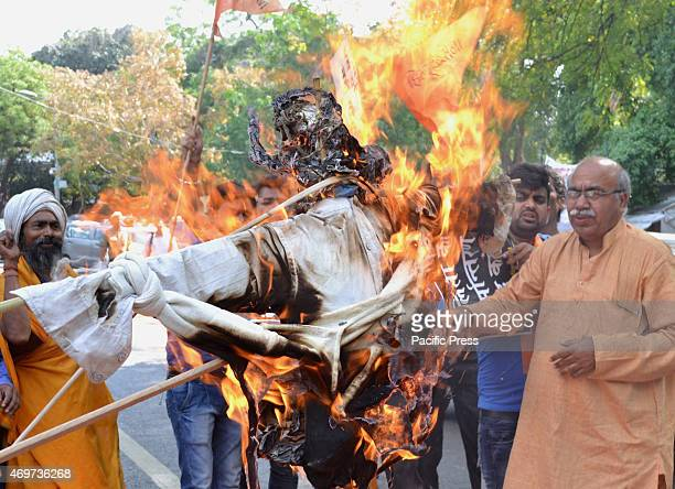 Hindu Sena activist protest and burn effigy of Azam Khan Samajwadi party leader and Uttar Pradeshs minister at Jantar Mantar against Dalit community...