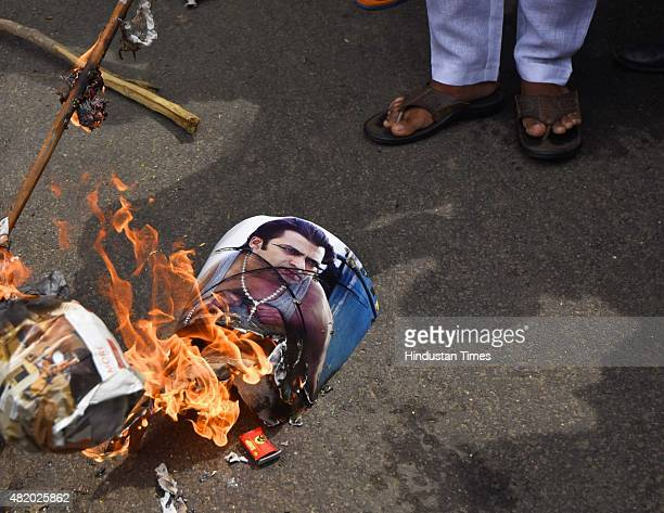Hindu Sena activists burn an effigy of Bollywood actor Salman Khan during a protest against his tweets in defence of Yakub Memon who was sentenced to...