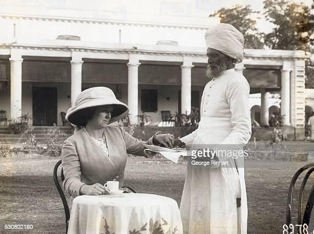 Hindu servant serving tea to a European colonial woman Undated photograph BPA#2 4362