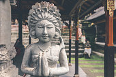 Hindu stone statue in the balinese temple. Tropical island of Bali, Indonesia. Asia.