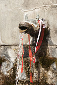 Hindu temple, sacred spring bull head water spout