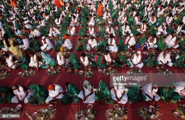 Hindu tribal couples who converted to Christianity a decade ago take an oath on Sunday not to abandon their original religion at a ceremony conducted...