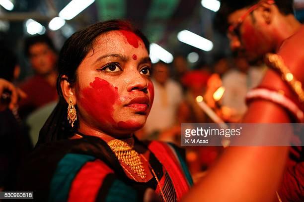 A hindu woman offering pooja to Bipadtarini Devi in Dhaka Bangladesh July 25 2015 During the ritual of people from Hindu community take long day...