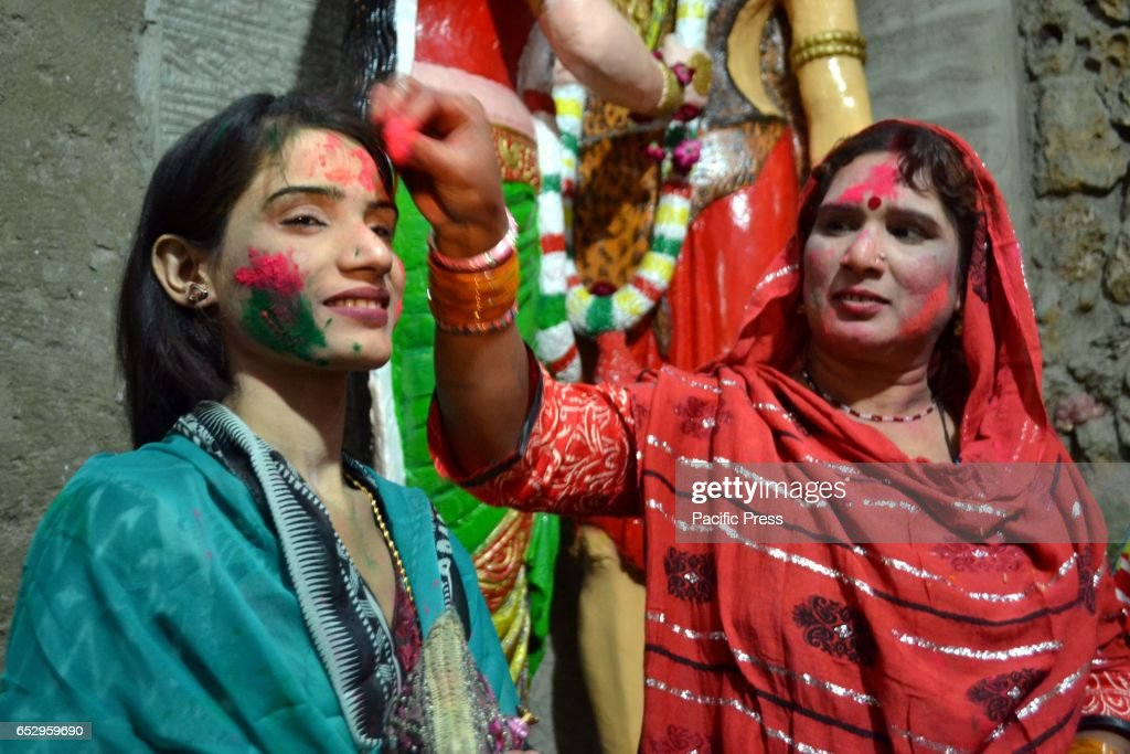 MANDIR, HYDERABAD, SINDH, PAKISTAN - : Hindu women are celebrating Holi while putting colors on each other faces at a local mandir of Hyderabad.