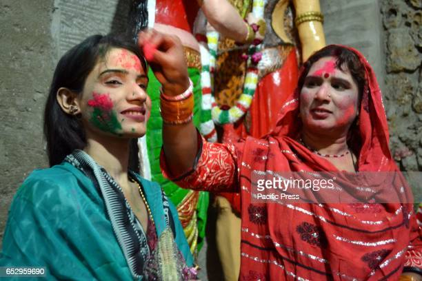 MANDIR HYDERABAD SINDH PAKISTAN Hindu women are celebrating Holi while putting colors on each other faces at a local mandir of Hyderabad