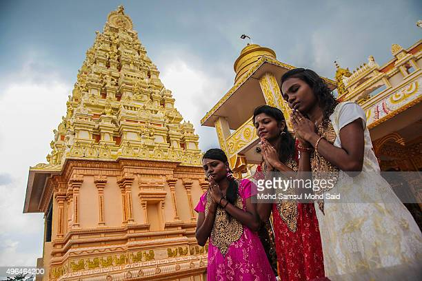 Hindu women are seen praying for Diwali celebrations inside a Hindu temple on November 10 2015 in Shah Alam Malaysia The Hindu community which...