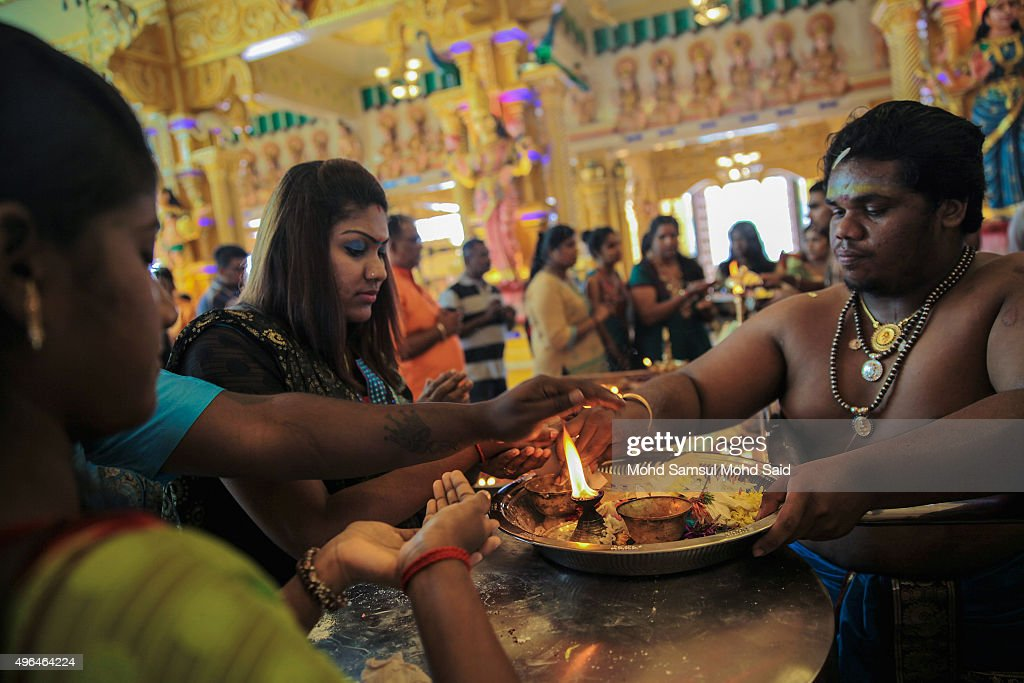 Hindu women are seen praying for Diwali celebrations inside a Hindu temple on November 10, 2015 in Shah Alam, Malaysia. The Hindu community, which consists of eight percent of Malaysia's population of 26 million, will celebrate Diwali, the festival of lights on November 10, known locally as Deepavali.