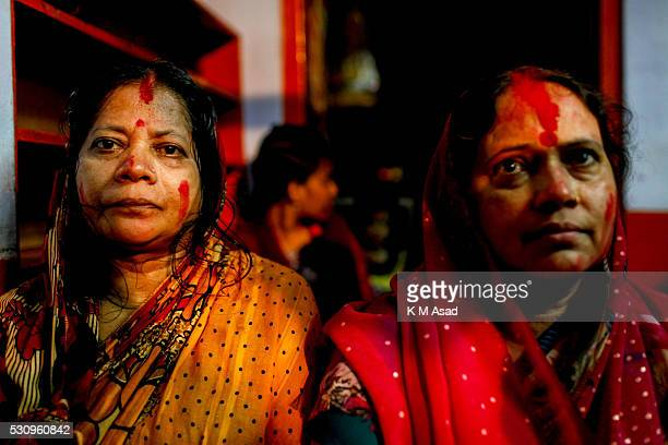 Hindu women offering pooja to Bipadtarini Devi in Dhaka Bangladesh July 25 2015 During the ritual of people from Hindu community take long day ritual...