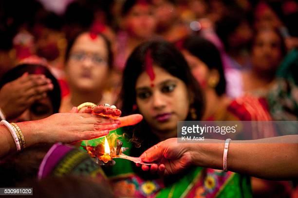 Hindu women take holy fire from their ritual for Hindu god to Bipadtarini Devi in Dhaka Bangladesh July 25 2015 During the ritual of people from...