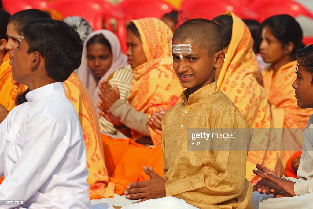 A Hindu youth of the Veda Vidyalaya looks on as he and others chant religious songs as they observe 'Shaurya Diwas', which marks the 20th anniversary of the demolition of the 16th century Babri Mosque in Ayodhya, at Karsevakpuram on December 6, 2012. The Babri mosque in the state of Uttar Pradesh was demolished by Hindu fundamentalists in 1992, claiming it was built on the site of the birth place of the Hindu God, Lord Rama.
