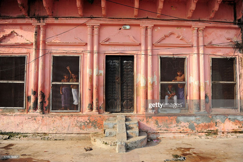 Hindu youth of the Veda Vidyalaya watch from a window as Indian soldiers patrol in Ayodhya on August 25, 2013. Indian police arrested leaders of a Hindu forum to try and prevent a march to a pilgrimage town where the 1992 razing of a mosque sparked deadly sectarian riots. Organisers from the Vishwa Hindu Parishad (VHP, World Hindu Council) and the Press Trust of India (PTI) said some 125 people were detained in the northern state of Uttar Pdaesh.