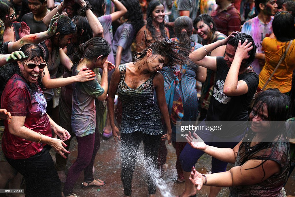 Hindus and tourists alike celebrate 'Holi' by spraying water and coloured powders at a temple in Kuala Lumpur on March 31, 2013. Holi, the festival of colours where people smear each other with coloured powder and water, is celebrated by Hindus across the country.