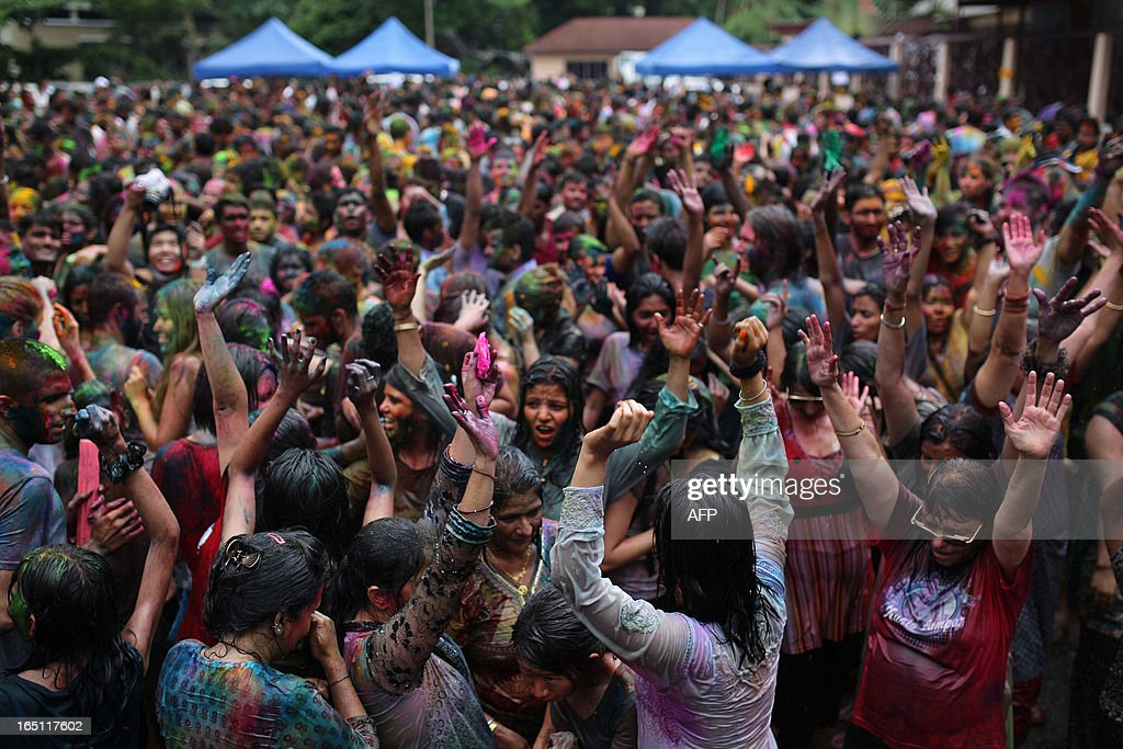 Hindus and tourists alike celebrate 'Holi' by spraying water and coloured powders at a temple in Kuala Lumpur on March 31, 2013. Holi, the festival of colours where people smear each other with coloured powder and water, is celebrated by Hindus across the country. AFP PHOTO / MOHD RASFAN