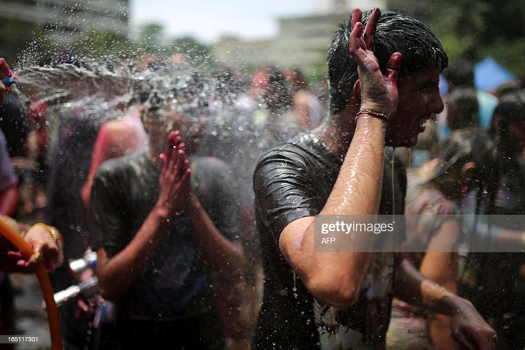 Hindus are sprayed with water as they celebrate 'Holi' at a temple in Kuala Lumpur on March 31, 2013. Holi, the festival of colours where people smear each other with coloured powder and water, is celebrated by Hindus across the country.
