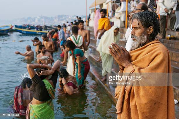 Hindus bathing and praying in the river Ganges, Varanasi, India