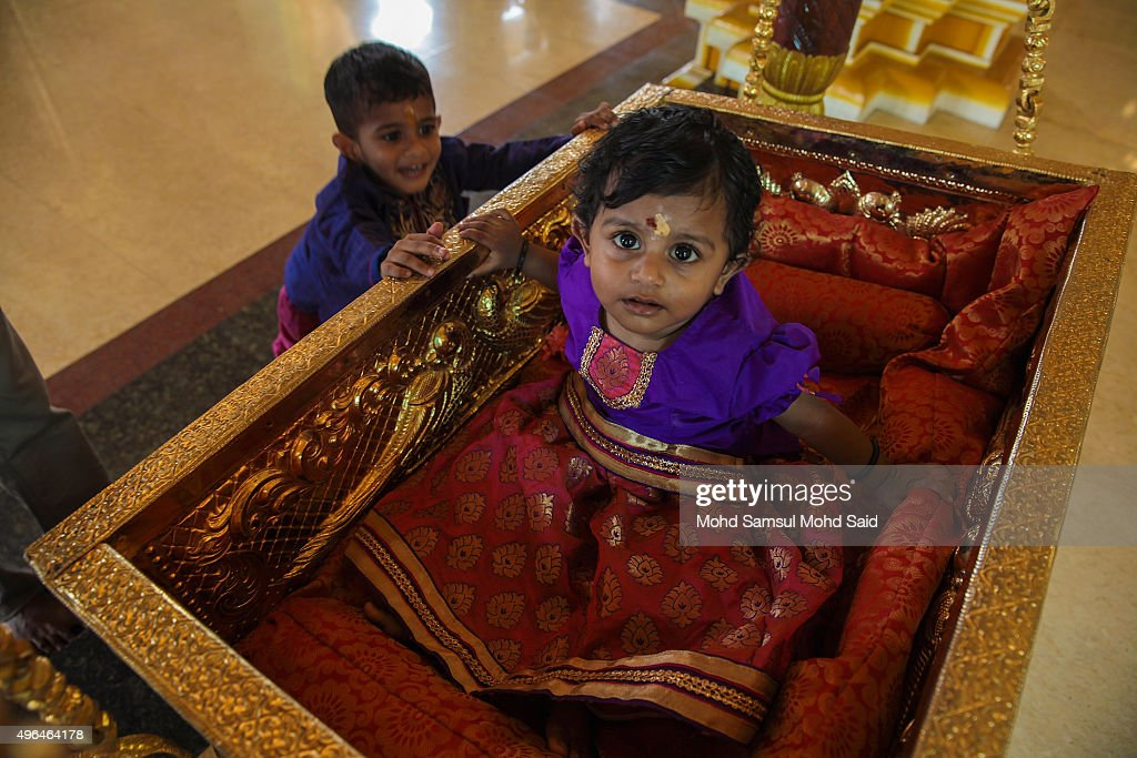 A Hindus children are seen play inside the temple during Diwali celebrations on November 10, 2015 in Shah Alam, Malaysia. The Hindu community, which consists of eight percent of Malaysia's population of 26 million, will celebrate Diwali, the festival of lights on November 10, known locally as Deepavali.