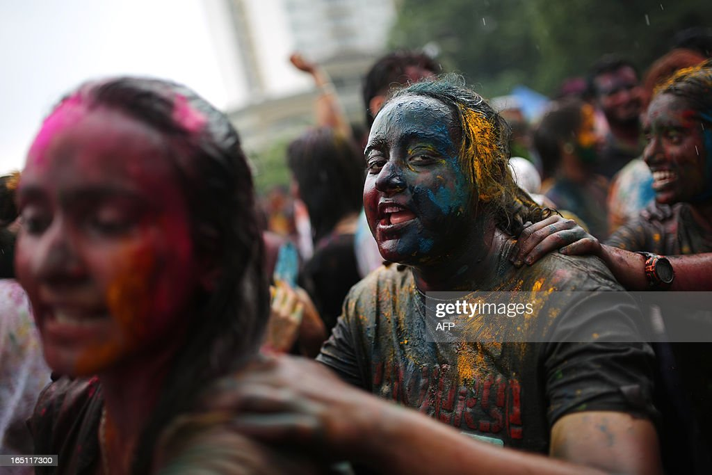 Hindus covered in coloured powders celebrate 'Holi' at a temple in Kuala Lumpur on March 31, 2013. Holi, the festival of colours where people smear each other with coloured powder and water, is celebrated by Hindus across the country.