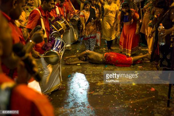 Hindus devotees possessed by the god reacts in a state of trance as he's heading to the Batu caves in Kuala Lumpur Malaysia on February 04 2017 To...