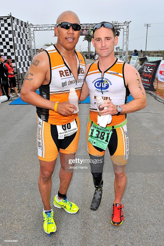 Hines Ward and Eric McElvenny celebrate with 'Got Chocolate Milk?' after finishing the SEAL Sprint III Triathlon on March 17, 2013 in San Diego, California.