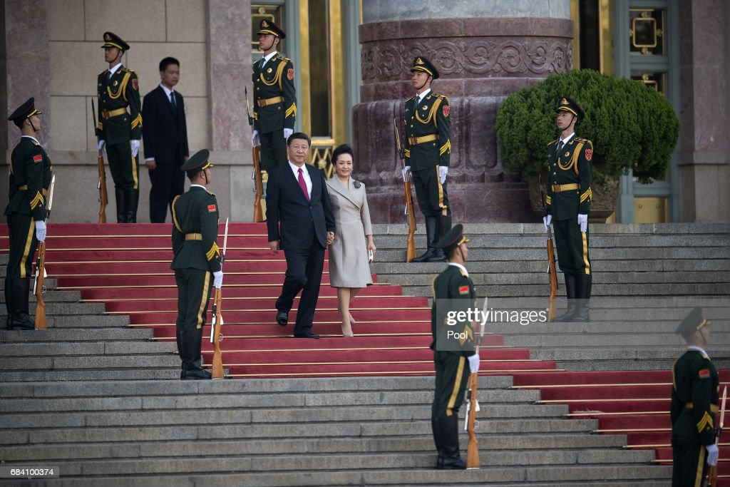 hinese President Xi Jinping (C, L) and his wife Peng Liyuan (C, R) walk down stairs during a welcome ceremony for Argentine President Mauricio Macri outside the Great Hall of the People on May 17, 2017 in Beijing, China. Macri is on a state visit to China after attending the Belt and Road Forum.