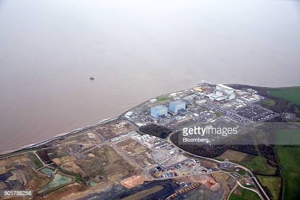 Hinkley Point B nuclear power station operated by Electricite de France SA's right stands near to groundworks for Hinkley Point C near Bridgwater UK...