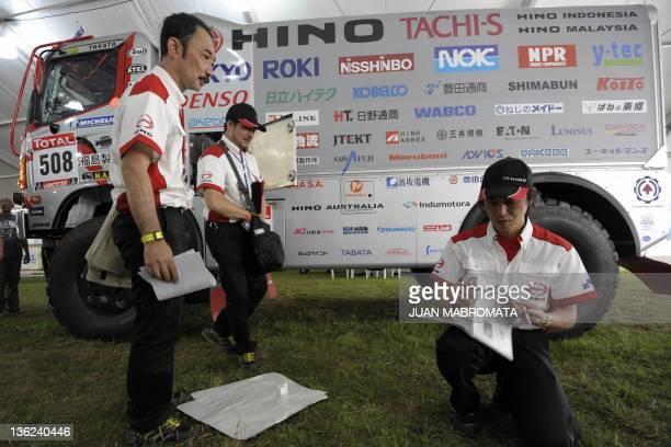 Hino truck driver Teruhito and codriver Seiichi Suzuki of Japan check documets during the technical verifications of the Dakar 2012 in Mar del Plata...