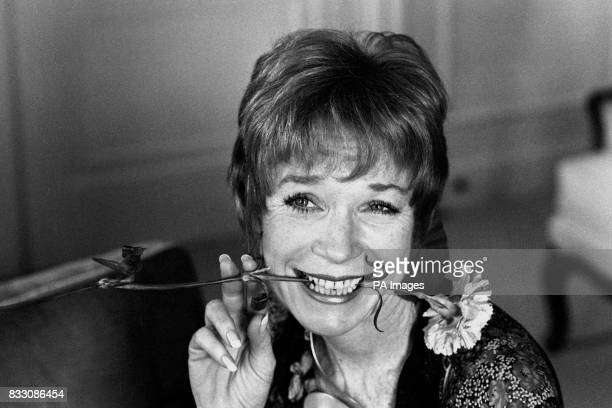 A hint of carnation snack for Hollywood superstar Shirley MacLaine in London where she is rehearsing for a series of ten spectaculars at the Apollo...