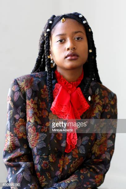 Hip, fashionable, African American model with braids
