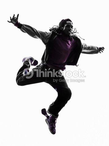 88f66f17c hip hop acrobatic break dancer breakdancing young man jumping silhouette :  Stock Photo