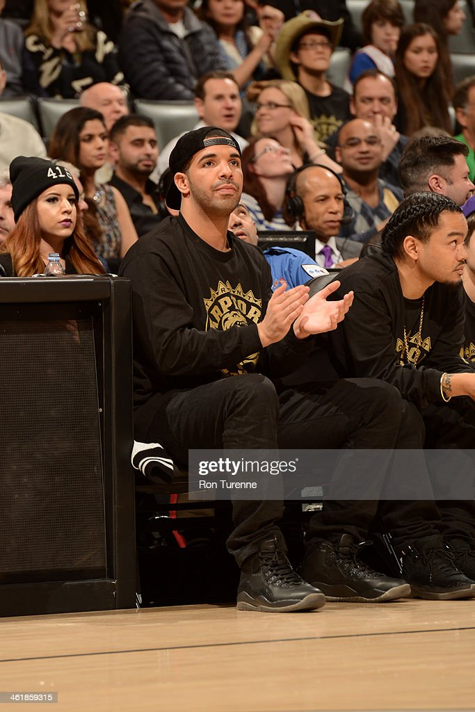 Hip Hop Artist Drake looks on where the Brooklyn Nets took on the Toronto Raptors during the game on January 11 2014 at the Air Canada Centre in...