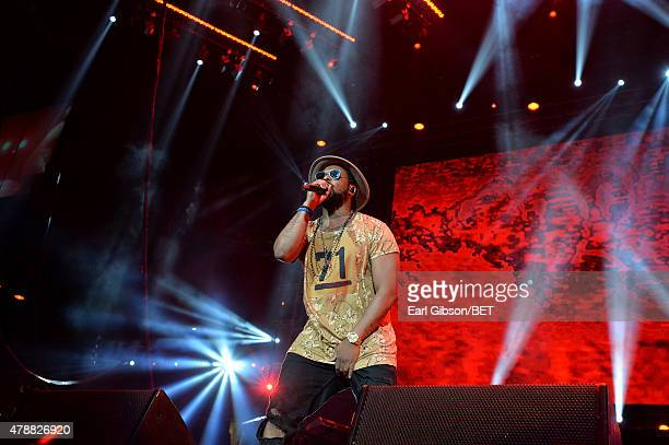 Hip hop artist Schoolboy Q performs onstage during the Ice Cube Kendrick Lamar Snoop Dogg Schoolboy Q AbSoul Jay Rock concert at Staples Center on...