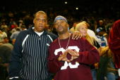 Hip Hop artists JayZ and Memphis Bleek catch the action between the New York Knicks and the Cleveland Cavaliers during a NBA regular season game at...