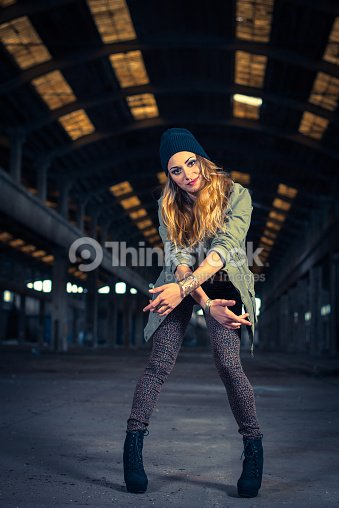 Hip Hop Dancer In An Abandoned Industrial Hall Stock Photo
