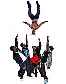 Hip hop dancer performing stunt with his friends pointing at him