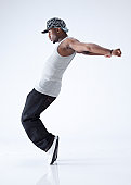 hip hop dancer standing on his toes