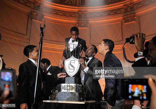 Hip hop mogul Sean 'Diddy' Combs is joined by his sons Justin Combs Christian Combs and Quincy Brown on stage to blow out candles on his 40th...