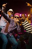 Hip hop musical group performing onstage