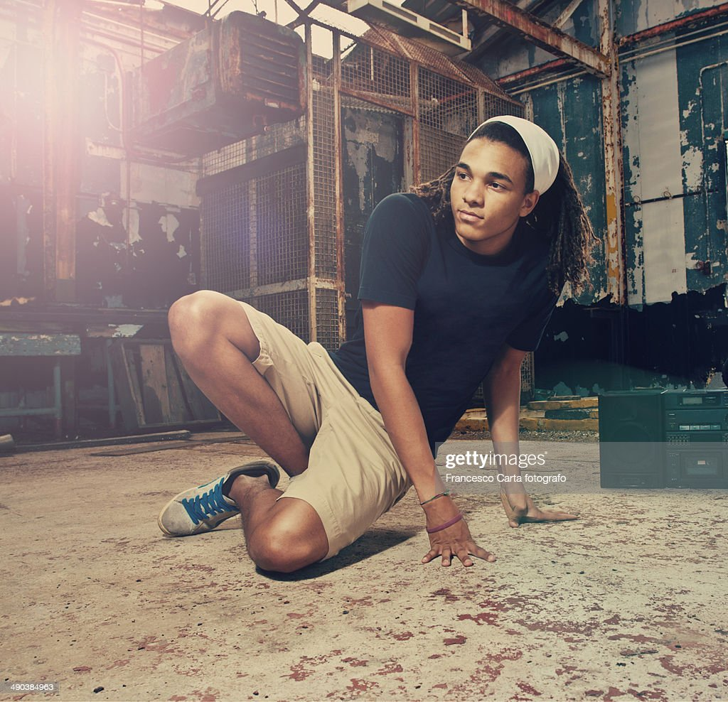 Hip hop portraits of a young man in the location of an old abandoned factory.