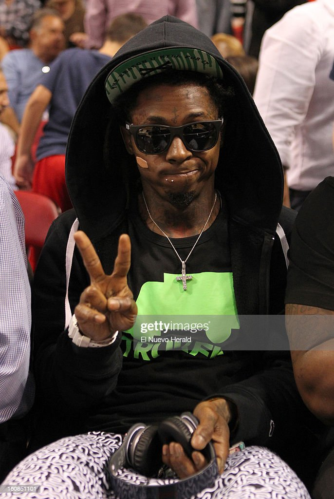Hip hop recording artist Lil Wayne poses for a picture during the second quarter of the Houston Rockets vs. Miami Heat game at the AmericanAirlines Arena in Miami, Florida, Wednesday, February 6, 2013. The Miami Heat defeated the Houston Rockets 114-108.