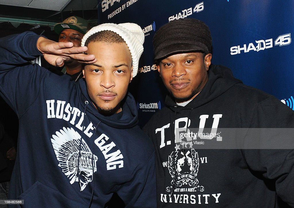 Hip hop recording artist/actor T.I. (L) and host of SiriusXM's Shade 45 Sway Calloway pose for pictures at the SiriusXM Studios on December 17, 2012 in New York City.