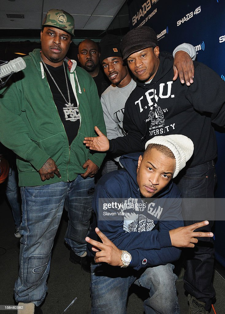 Hip hop recording artist/actor <a gi-track='captionPersonalityLinkClicked' href=/galleries/search?phrase=T.I.&family=editorial&specificpeople=221599 ng-click='$event.stopPropagation()'>T.I.</a> (Front R), host of SiriusXM's Shade 45 <a gi-track='captionPersonalityLinkClicked' href=/galleries/search?phrase=Sway+Calloway&family=editorial&specificpeople=214641 ng-click='$event.stopPropagation()'>Sway Calloway</a> (Back R) and guests pose for pictures at the SiriusXM Studios on December 17, 2012 in New York City.