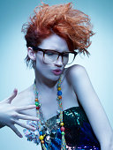 hip redhead girl with glasses