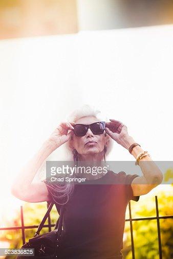 Hip senior woman wearing sunglasses