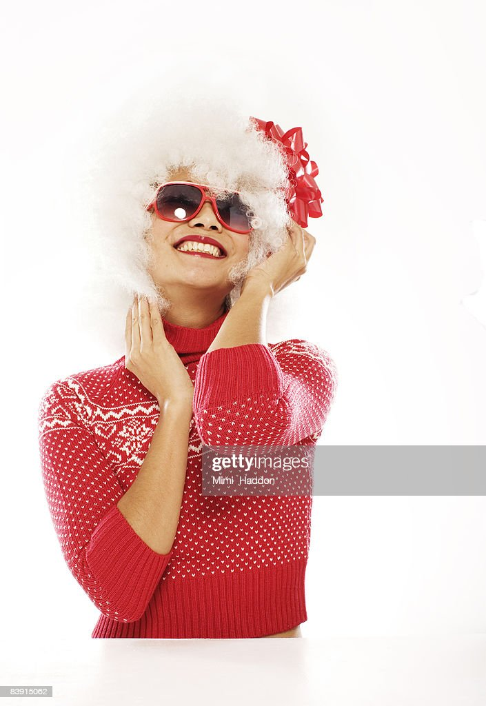 hip woman with red bow in hair : Stock Photo