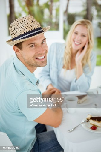 Hip young couple having coffee together : Photo