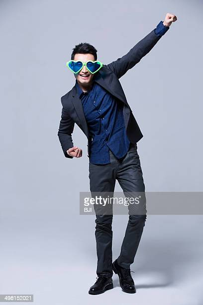 Hip young man wearing big sunglasses