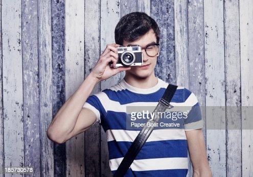 Hip young student taking a photo with film camera : Stock Photo